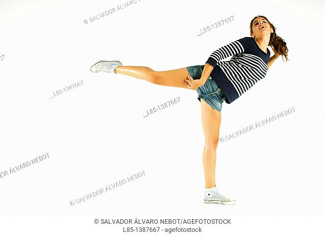 Young girl dancing on a white background