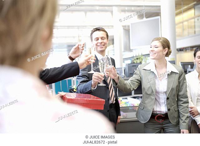 Coworkers toasting at office party