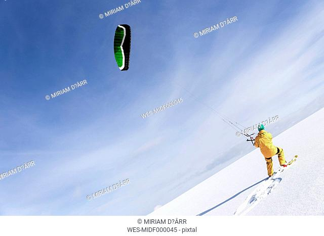 Germany, Baden-Wuerttemberg, Waldshut-Tiengen, kite surfer in snow