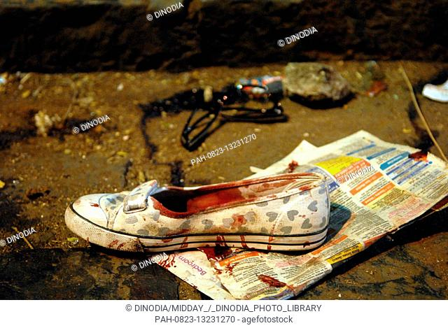 One shoe with blood stains at CST train station after Mumbai was attacked by Deccan Mujahideen terrorists in South Mumbai India 26/11/2008