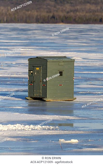 Ice fishing hut on Lake Wolsey, Manitoulin Island, Ontario, Canada