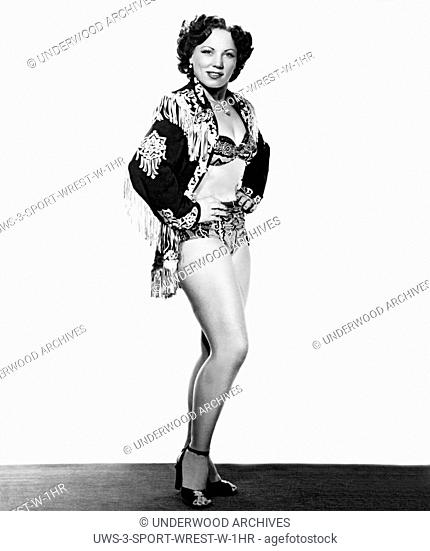 Boston, Massachusetts: c. 1953 A studio portrait of professional woman wrestler and current world champion, June Byers