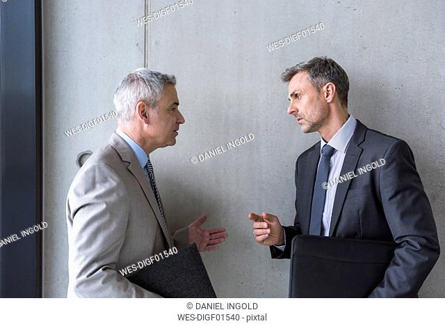 Two businessmen having an informal meeting