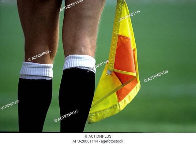Football referee holding a flag