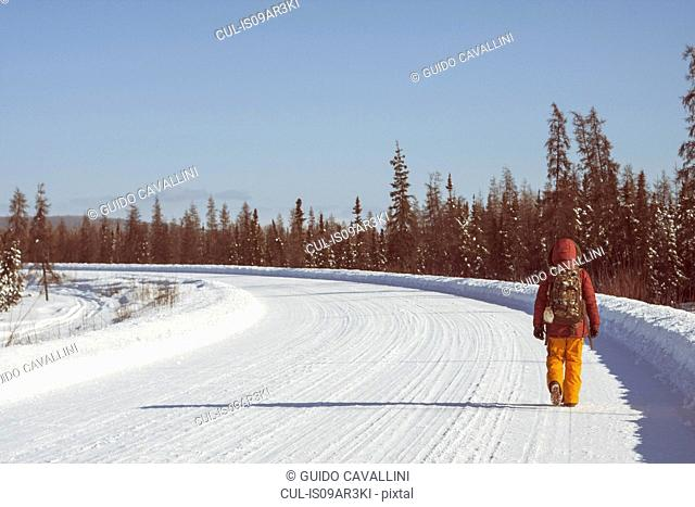 Person walking on snow covered road, Fairbanks, Alaska