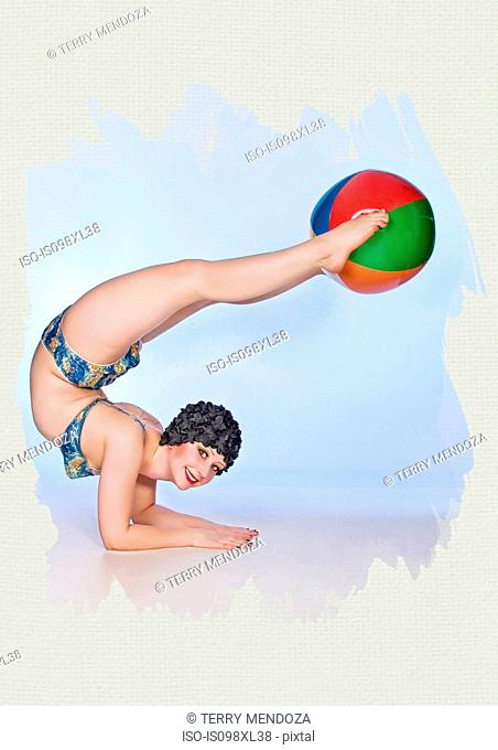 Pin-up girl with beach ball between her feet