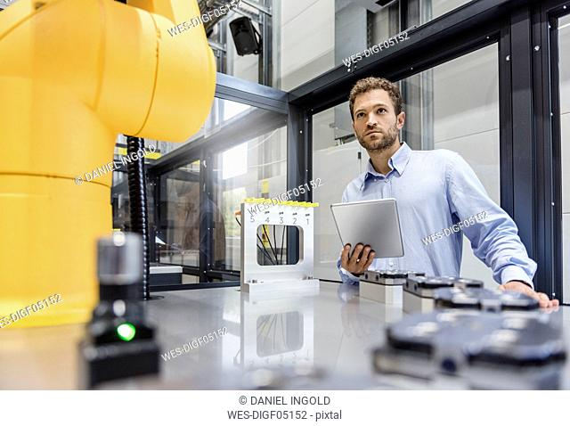 Businessman, working in a manufacturing company, using digital tablet