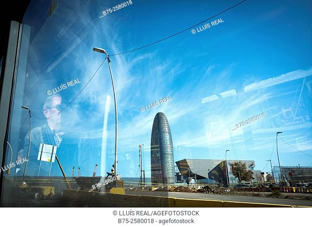 Torre Agbar View from the window of a bus, with reflections in the glass. Skyscraper designed by French architect Jean Nouvel, opened in 2005
