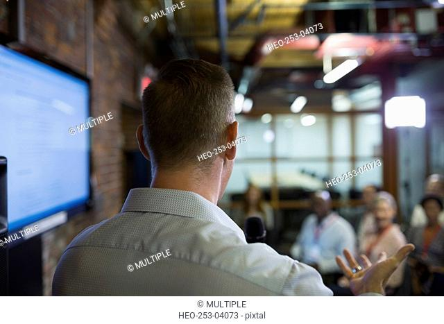 Businessman speaking to conference audience