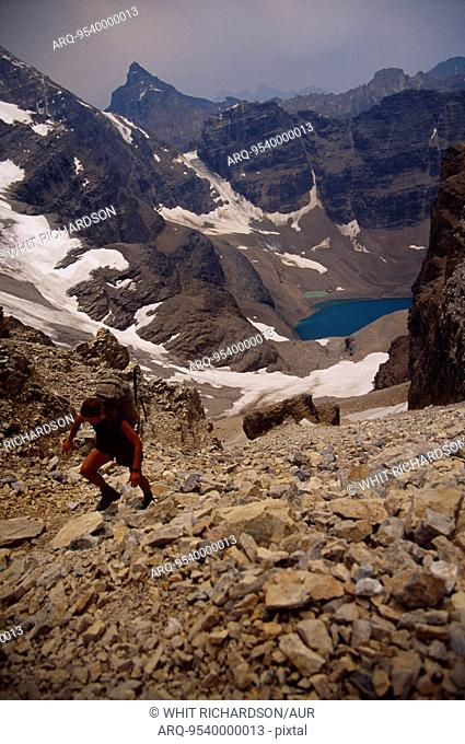 Woman hiking up talus, Canada