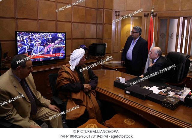 Egyptian presidential candidate and chairperson of El-Ghad Party Moussa Mostafa Moussa (R) watches the results of the 2018 Egyptian presidential elections