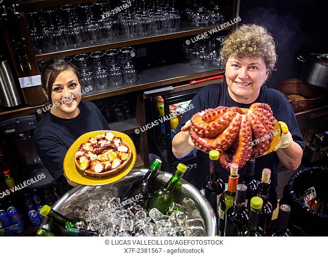 Waitresses showing at right Octopus and at left 'Pulpo a feira' octopus in Galician style, in Pulperia Melide, Plaza de España 16 or Plaza Campo de la Leña 16
