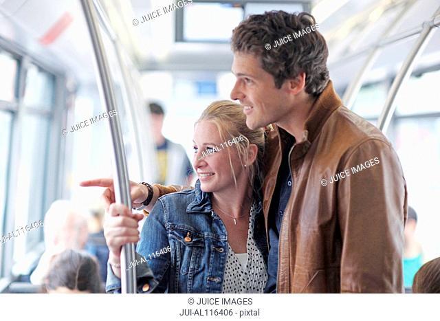 Mid adult couple passengers travelling on city break, Munich, Bavaria, Germany, Europe