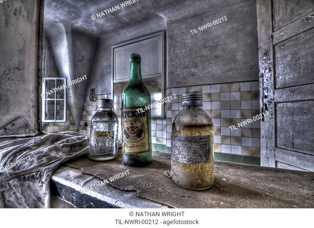 Abandoned lunatic asylum north of Berlin, Germany Old bottles on shelf