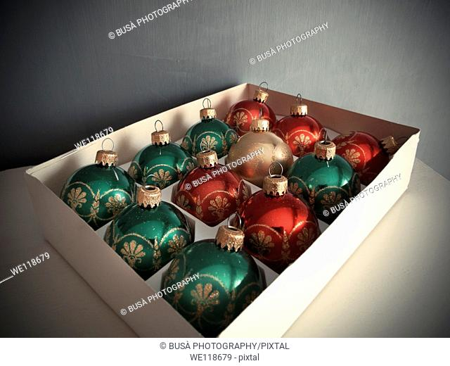 Box full of Traditional green and red Christmas balls
