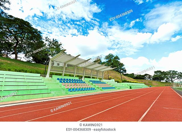 Stadium chairs and running track in a sports ground