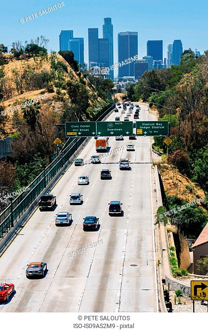 View of highway and city skyline, Los Angeles, California, USA