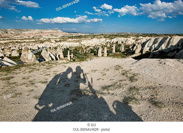 Selfie shadow of tourists on moped in landscape, Cappadocia, Anatolia,Turkey