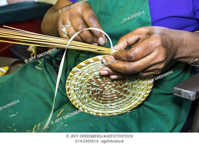 South Carolina, SC, Charleston, Historic Downtown, Charleston City Market, shopping, vendor, weaving, Black, woman, Sweetgrass, basket, Gullah, heritage, craft