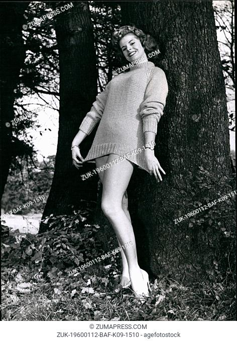 1962 - Trunk Call: Girl who called over from the tree trunk is Marilyn Davies, showing off her long jumper. (Credit Image: © Keystone Pictures USA/ZUMAPRESS