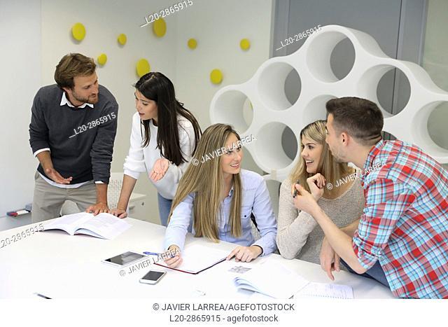 Group of students doing a joint work, University of the Basque Country, San Sebastian, Donostia, Gipuzkoa, Spain