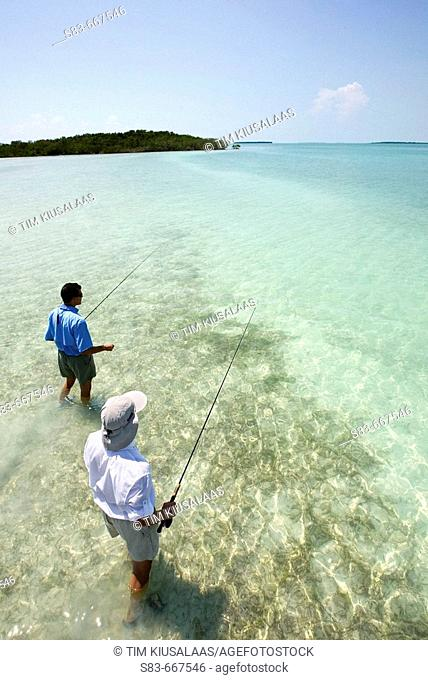 Two men flyfishing on a Grass flat in the Florida Keys