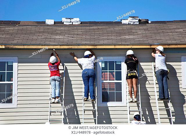 New Orleans, Louisiana - Student volunteers from California work on construction of new homes being built by Habitat for Humanity  Habitat volunteers have built...