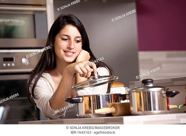 Young woman cooking a meal