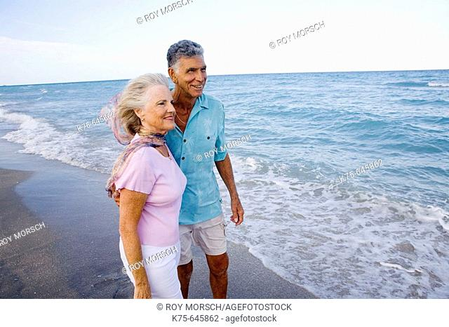 Senior couple looking out at the ocean