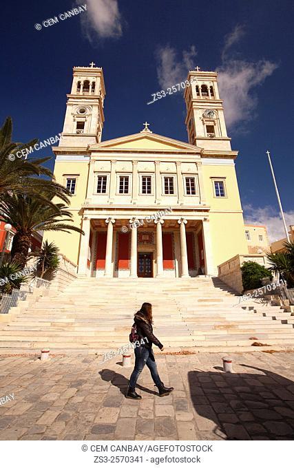 Woman in front of the Neo Classic Greek Orthodox Church of Saint Nicholas, Ermoupolis, Syros, Cyclades Islands, Greek Islands, Greece, Europe