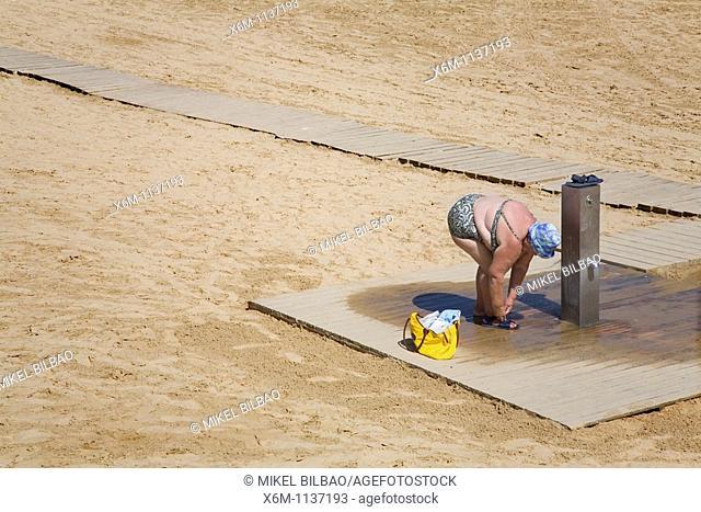old woman on a beach