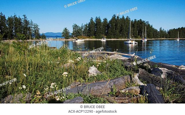 Boats anchor in Rebecca Spit Marine Provincial Park on Quadra Island, off the east coast of Vancouver Island, British Columbia, Canada