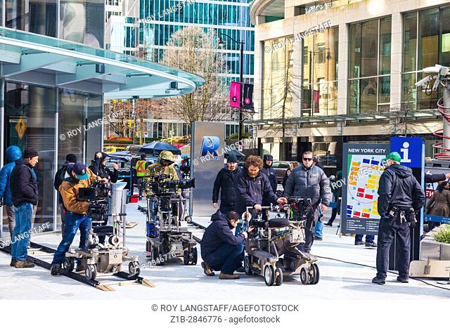 Movie set on the streets of Vancouver simulating a crowd protest in New York City