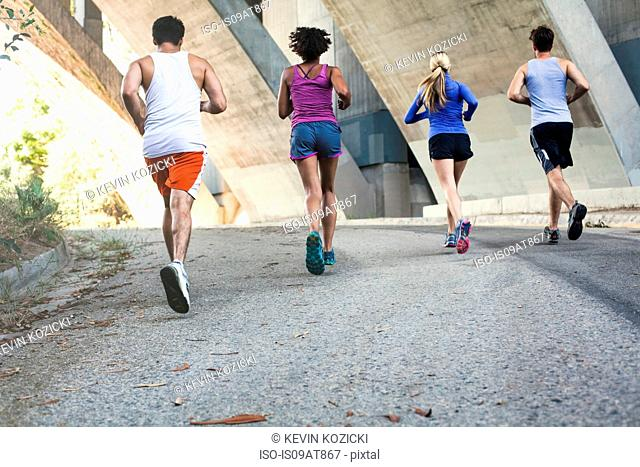 Joggers running on bridge, Arroyo Seco Park, Pasadena, California, USA