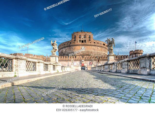 "Ancient bridge on Tiber river """"Saint Angel"""" and """"castle Saint Angel"""" tomb of Roman emperor Hadrian. Rome - Italy"