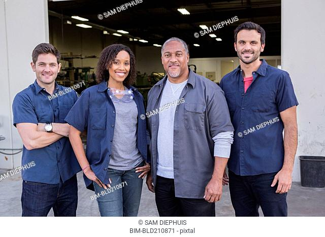 Workers smiling outside warehouse