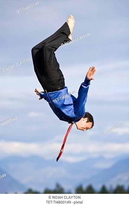 USA, Montana, Whitefish, businessman mid-air