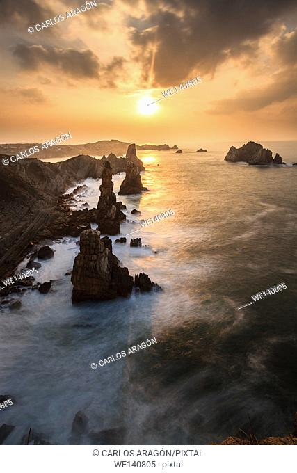 Spectacular sunset on the coast of Liencres, Cantabria, Spain