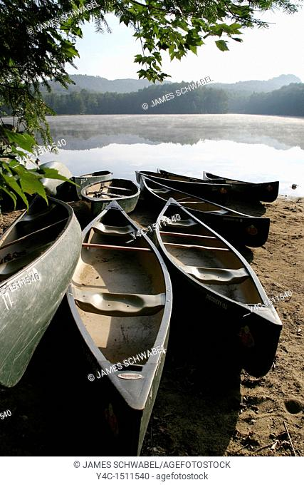 Canoes on the shore of lake in the Adirondack Mountains of New York State