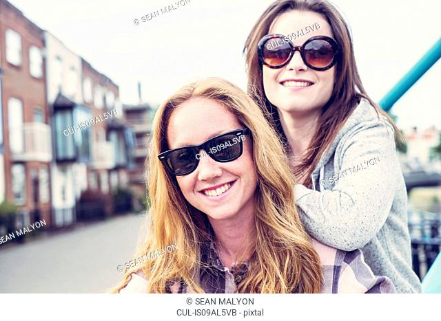 Portrait of two young female best friends in sunglasses
