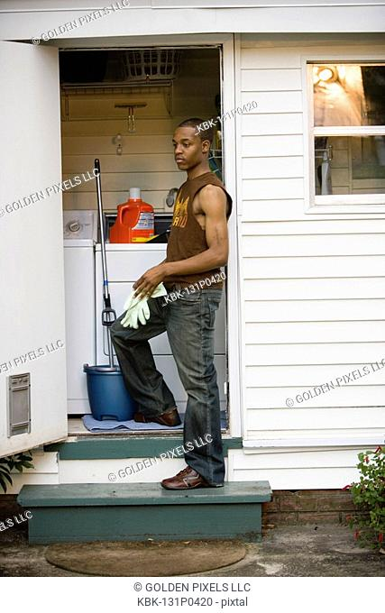 Young man doing household chores