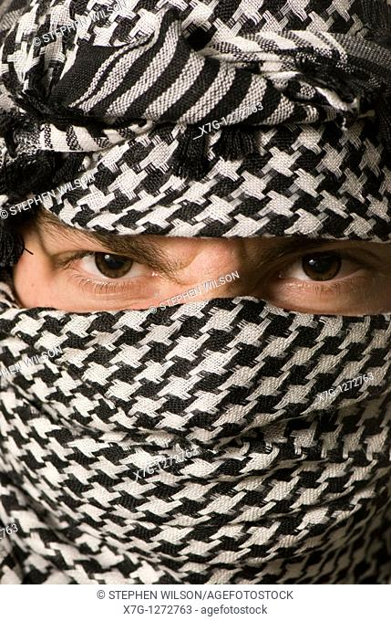Close up of eyes in Arab shemagh headscarf