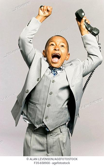 Kid in suit on phone