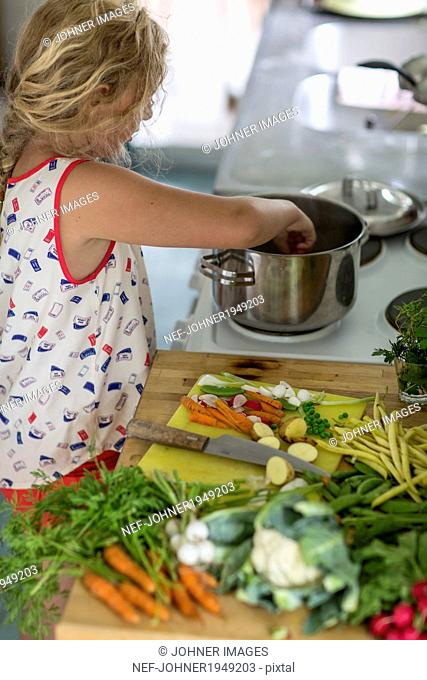 Girl cooking in kitchen, Sweden