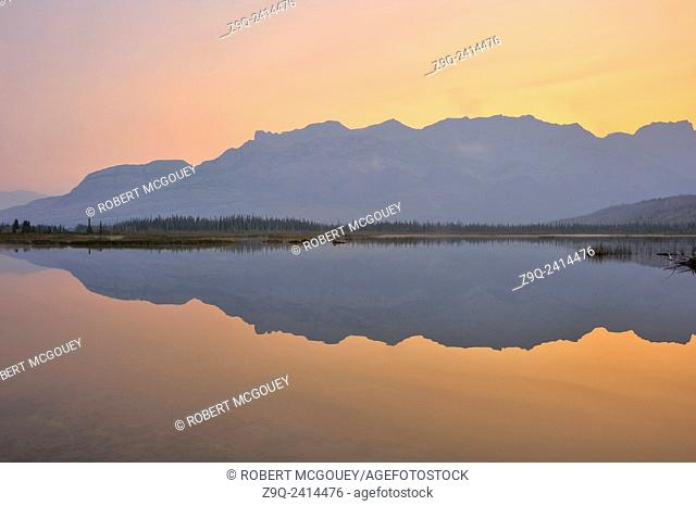 This image of the Miette Mountain rrrange reflecting in the calm waters of Talbot lake was captured in early morning in Jasper National Park Alberta Canada