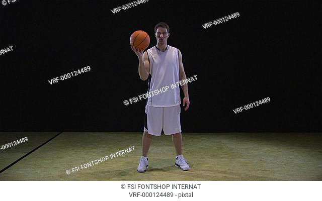 SLO MO, WS, Lockdown, basketball player spinning a basketball on his finger