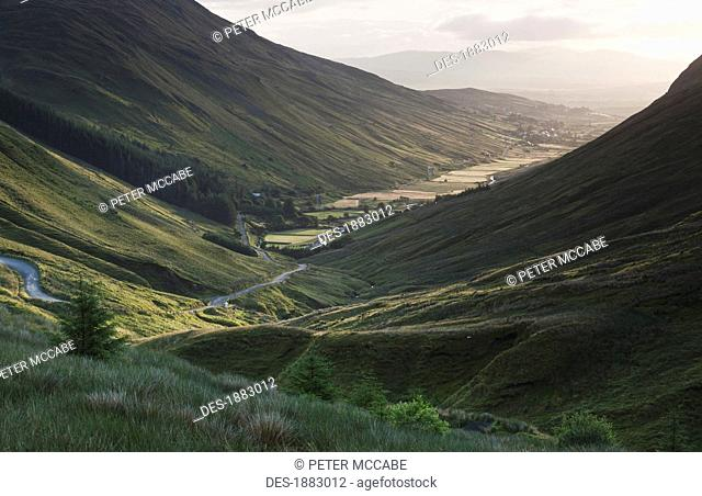 Sunlight Creeping Up The Mountain Valley At The Glengesh Pass, County Donegal, Ireland