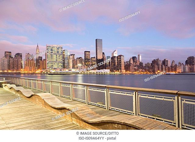 New York City skyline lit up at dusk