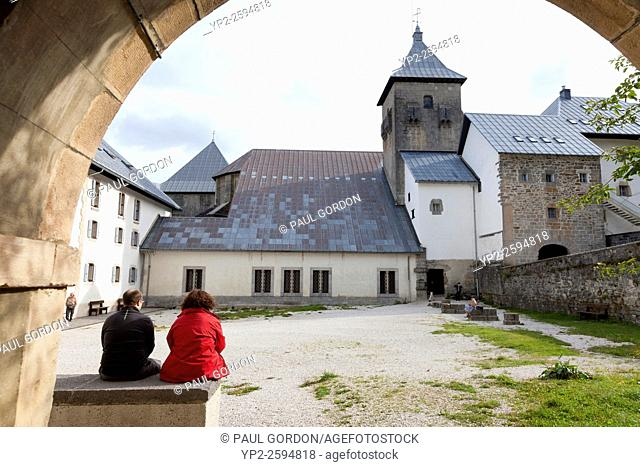 Pilgrims resting in the courtyard of the Albergue de Roncesvalles - Navarre, Spain. The albergue is run by the Dutch Society of St. James