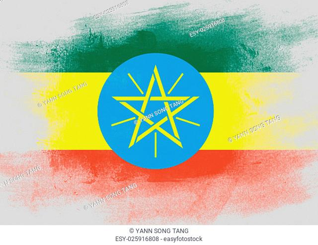 Flag of Ethiopia painted with brush on solid background